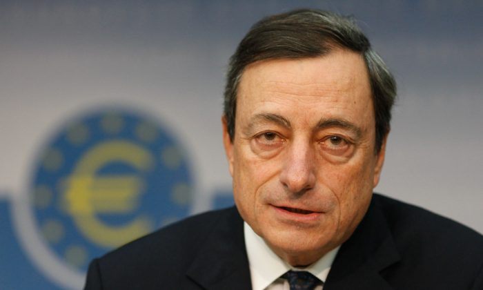 Mario Draghi, president of the European Central Bank (ECB), speaks to the media following the first meeting of the ECB Governing Council after he took the helm, in Frankfurt, Germany, Nov. 3, 2011.   (Ralph Orlowski/Getty Images)