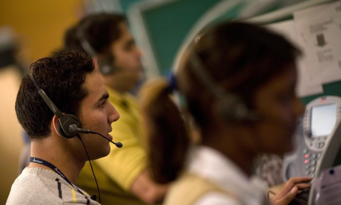 Indian operators take calls at Quatrro call-centre in Gurgaon on the outskirts of New Delhi in this file photo. (Findlay Kember/AFP/Getty Images)