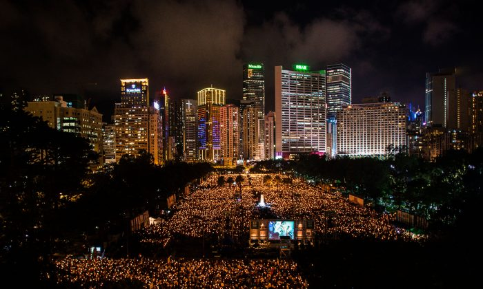 An estimated 180,000 people gather in Hong Kong's Victoria Park for a candlelight vigil memorializing the victims of the Tiananmen Square massacre and calling for the overthrow of the Chinese Communist Party, on June 4, 2014. (Phillipe Lopez/AFP/Getty Images)