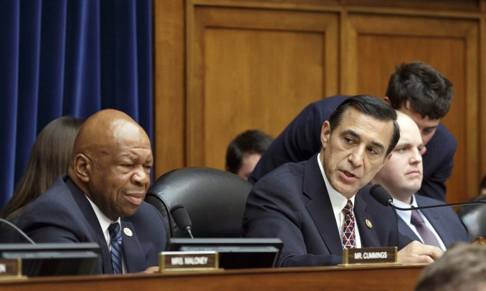 Rep. Darrell Issa (R-Calif.) (R) and Rep. Elijah Cummings, (D-Md.) on Capitol Hill in Washington, Monday. They co-sponsored a bill to strengthen the Freedom of Information Act. (AP Photo)