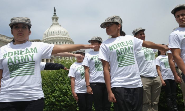 Undocumented youth show their support for the ENLIST Act at a rally in front of the U.S. Capitol on May 20, 2014. (Somodevilla/Getty Images)
