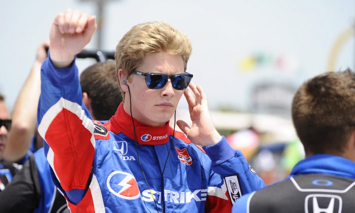 Josef Newgarden prepares for qualifying for an IndyCar auto race at Texas Motor Speedway in Fort Worth, Friday, June 6, 2014. (AP Photo/Ralph Lauer)