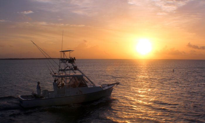 Sunset on the Atlantic Ocean. A new day begins sport fishing off Islamorada in the Florida Keys. (Myriam Moran copyright 2014)