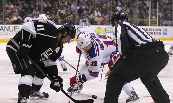 Anze Kopitar of the Los Angeles Kings and Brad Richards of the New York Rangers prepare to take a face-off in Los Angeles on Oct. 7, 2013. (Victor Decolongon/Getty Images)