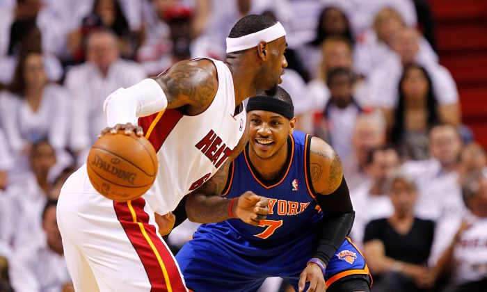 LeBron James #6 of the Miami Heat posts up Carmelo Anthony #7 of the New York Knicks during Game Two of the Eastern Conference Quarterfinals in the 2012 NBA Playoffs at American Airlines Arena on April 30, 2012 in Miami, Florida.  (Mike Ehrmann/Getty Images)