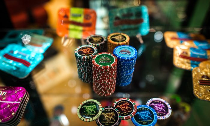 Gaming coins are displayed at a booth of the Global Gaming Expo Asia in the world's biggest gambling hub of Macau on May 20, 2014. (Philippe Lopez/AFP/Getty Images)
