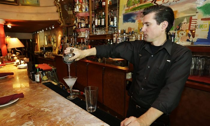 Gradie Wallen tends bar at the icon Grill in Seattle, June 2. (AP Photo/Ted S. Warren)