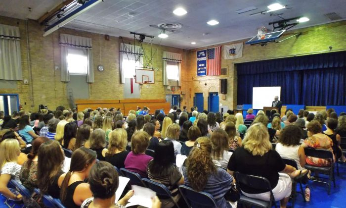 """Over 100 educators from the North Arlington Public Schools in New Jersey assemble for a professional development session conducted by Vincent J. Bove prior to the school year on Sept. 3, 2013. All attendees received copies of """"Early Warning Timely Response: A Guide to Safe Schools."""" (Vincent J. Bove)"""