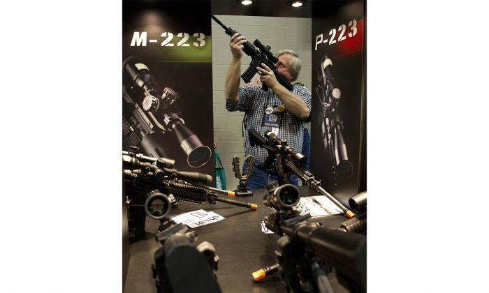 A gun enthusiast checks out a scope at the 143rd NRA Annual Meetings and Exhibits in Indianapolis, Indiana on April 26, 2014. (Karen Bleier/AFP/Getty Images)