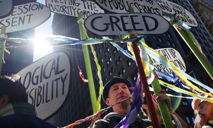 Protesters affiliated with Occupy Wall Street, taking aim at inequality and financial greed, demonstrate in New York on Sept. 17, 2013. (Spencer Platt/Getty Images)