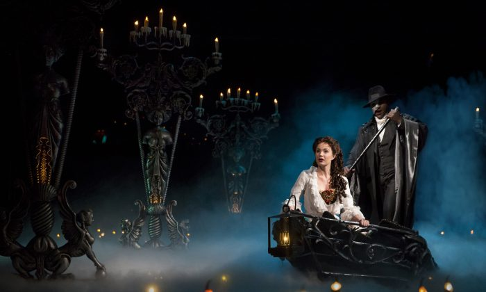 Christine (Sierra Boggess) is spirited away by the Phantom (Norm Lewis) to his underground world. (Matthew Murphy)