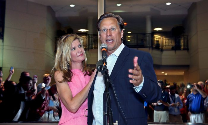 Dave Brat and his wife Laura address supporters after defeating Congressman Eric Cantor in the Republican primary for the 7th Congressional District in Virginia, June 10, 2014 in Henrico, Va. (AP Photo/Richmond Times-Dispatch, P. Kevin Morley)