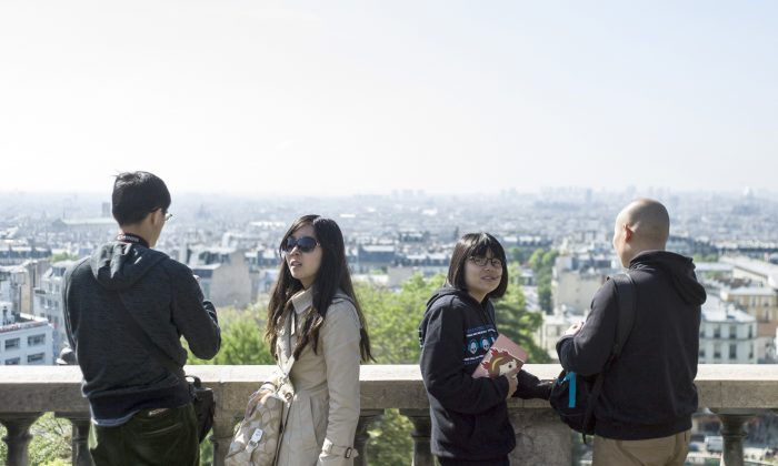 Chinese tourists visit the Montmartre neighborhood in the city of Paris on May 16, 2014. (Fred Dufour/AFP/Getty Images)