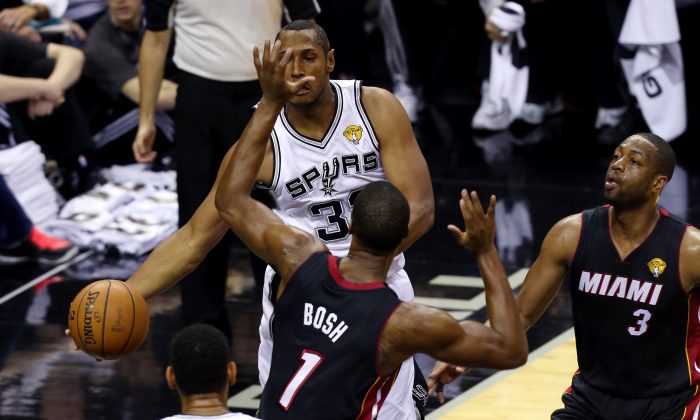 The Spurs passed their way over, around and through the Miami Heat to win the 2014 NBA Championship. (Chris Covatta/Getty Images)