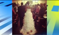 Bride Attaches Her Baby to Wedding Dress (Video)