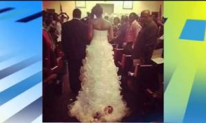 Bride Attaches Her Baby to Wedding Dress (Video)