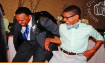 Father and Son Battle in Epic Wedding Dance-Off (Video)