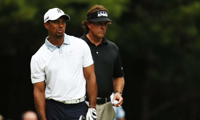 Tiger Woods and Phil Mickelson of the USA react on the 11th tee during the second round of the Deutsche Bank Championship at TPC Boston on August 31, 2013 in Norton, Massachusetts. (Jim Rogash/Getty Images)