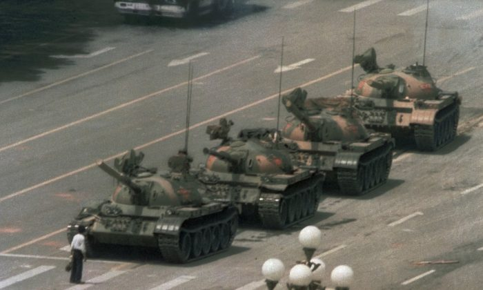 This image is how most of the world remembers  the Tiananmen Square Massacre that is now entering its 27th year anniversary. The Chinese regime has been trying to have people forget about it by censoring  discussions and having 1989 banned from textbooks and Chinese websites. (AP Photo/Jeff Widener)