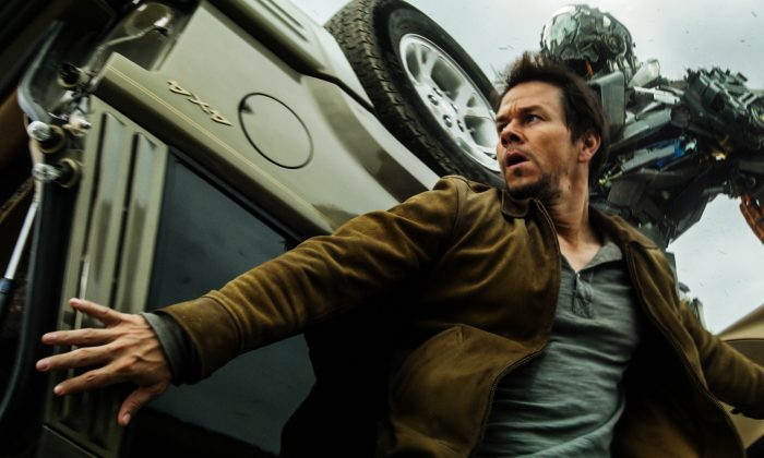 "Cade Yeager (Mark Wahlberg) is chased by Autobot Lockdown in ""Transformers: Age of Extinction."" (Paramount Pictures)"