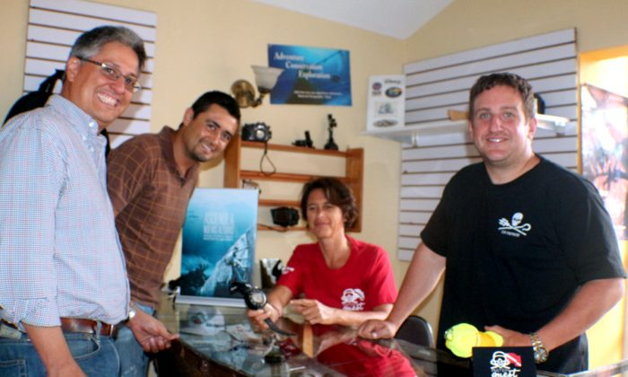 Divers Paul Rodiguez, Amerigo Moran with Sabine Steiner (seated) and Bill Schoening in Water Quest's dive shop in Guatemala City. (Myriam Moran copyright 2014)
