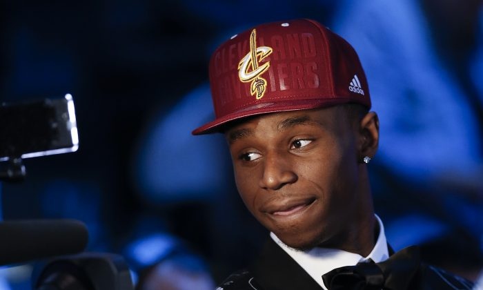 Andrew Wiggins of Kansas stops for a television interview after being selected by the Cleveland Cavaliers as the number one pick in the 2014 NBA draft, Thursday, June 26, 2014, in New York. (AP Photo/Kathy Willens)