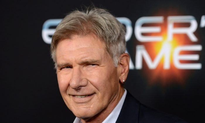 "This Oct. 28, 2013, photo shows actor Harrison Ford at the LA Premiere of ""Ender's Game"" in Los Angeles. Ford is recuperating after surgery to heal a broken leg suffered during production on ""Star Wars: Episode VII."" (Jordan Strauss/Invision/AP)"