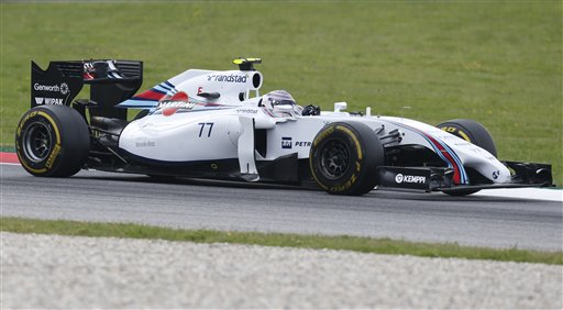 Williams driver Valtteri Bottas of Finland steers his car during the first training session at the race track  in Spielberg, Austria, Friday, June 20, 2014. The Austrian Formula One Grand Prix will be held on Sunday. (AP Photo/Darko Bandic)