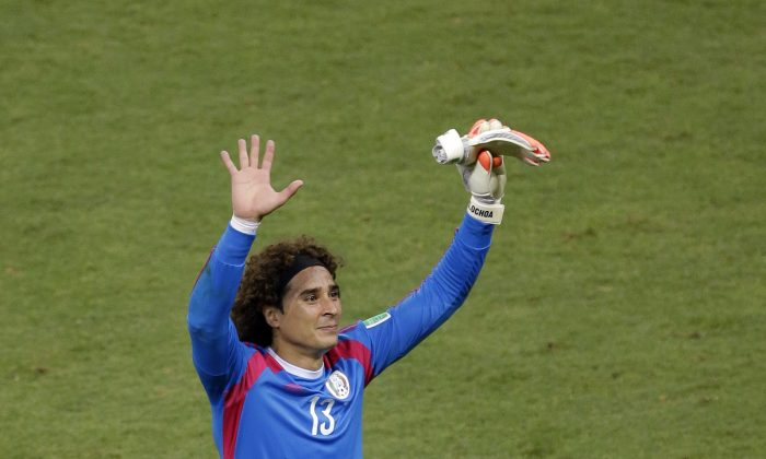 6cbe614f0 Mexico's goalkeeper Guillermo Ochoa waves to fans after the group A World  Cup soccer match between