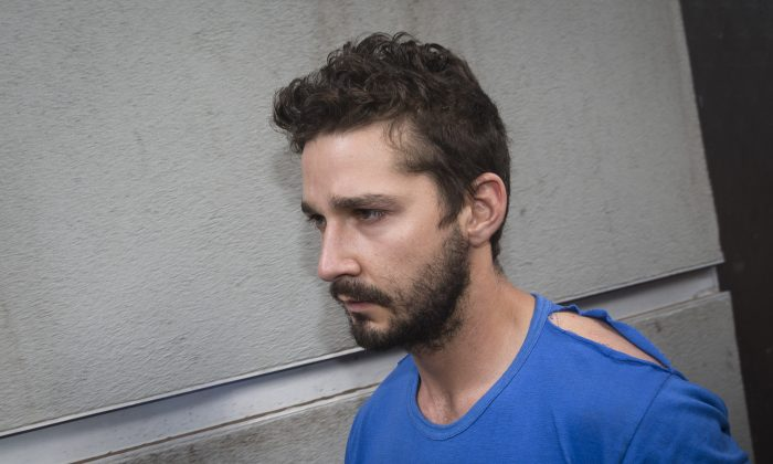 """Actor Shia LaBeouf leaves Midtown Community Court after being arrested the previous day for yelling obscenities at the Broadway show """"Cabaret,"""" in New York on June 27, 2014.  (AP Photo/John Minchillo)"""