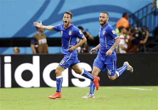 Italy's Claudio Marchisio, left, celebrates with Daniele De Rossi, right, after Marchisio scored Italy's first goal during the group D World Cup soccer match between England and Italy at the Arena da Amazonia in Manaus, Brazil, Saturday, June 14, 2014. (Antonio Calanni)