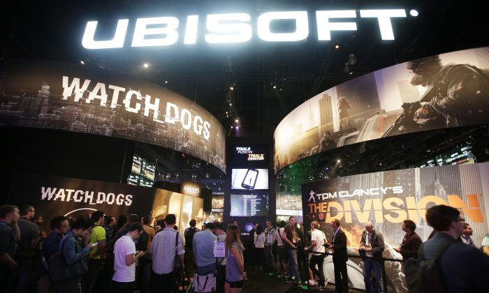 "FILE - This June 12, 2013 file photo shows attendees waiting in line for  presentations on the video games, ""Watch Dogs"" and ""Tom Clancy's The Division"" at the Ubisoft booth during the Electronic Entertainment Expo in Los Angeles. The recent success of ""Watch Dogs"" and ""Titanfall"" is paving the way for several new video games that don't contain numbers in their titles to be hyped at next week's Electronic Entertainment Expo, the gaming industry's annual trade show held on June 10-12, 2014, in Los Angeles. With anticipation mounting for original games like ""Destiny,"" ""The Order: 1886"" and ""Sunset Overdrive,"" have game makers finally discovered the cure for sequelitis? (AP Photo/Jae C. Hong, file)"