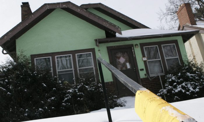 Depending on the degree of distress, a home's fix-up costs can be elevated, requiring additional skill in managing the renovations. (AP photo/Jim Mone)