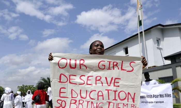 A woman holds a sign to call for the release of more than 200 schoolgirls kidnapped by Boko Haram militants on May 19, 2014 during a sit-in orchestrated by human rights organizations in Abidjan. (Sia Kambou/AFP/Getty Images)