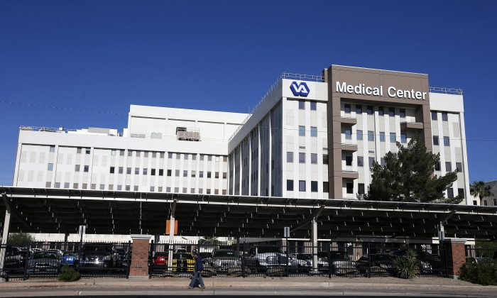 This April 28, 2014, photo shows the Phoenix VA Health Care Center in Phoenix. The Veterans Affairs Department says more than 57,000 patients are still waiting for initial medical appointments at VA hospitals and clinics 90 days or more after requesting them. (AP Photo/Ross D. Franklin)