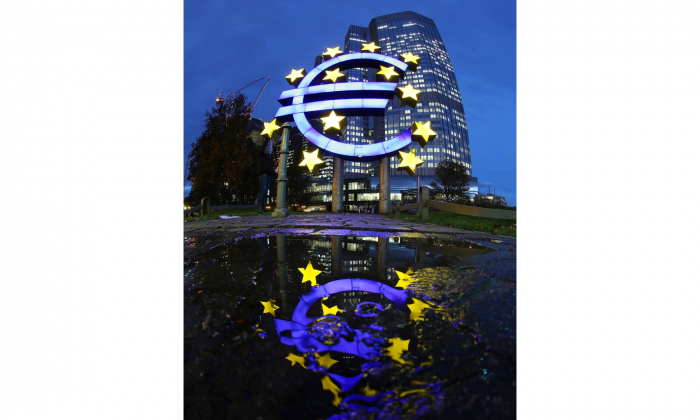 The giant Euro symbol reflected outside the headquarters of the European Central Bank (ECB) in Frankfurt, Germany. Opposition to the Canada-EU Comprehensive Economic and Trade Agreement (CETA) is brewing in Europe and could sink the deal, suggests Scott Sinclair, the director of Canadian Centre for Policy Alternative's Trade and Investment Research Project. (Hannelore Foerster/Getty Images)