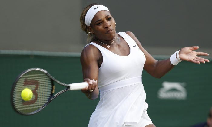 Serena Williams of U.S. plays a return to Alize Cornet of France during their women's singles match at the All England Lawn Tennis Championships in Wimbledon, London, Saturday, June 28, 2014. (AP Photo/Sang Tan)