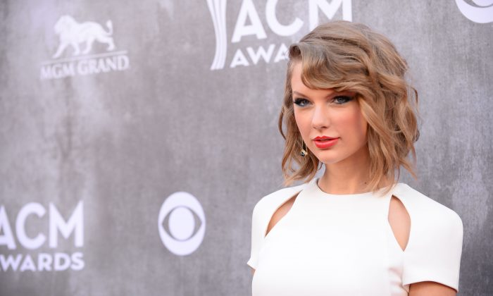 In this Sunday, April 6, 2014, file photo, Taylor Swift arrives at the 49th annual Academy of Country Music Awards at the MGM Grand Garden Arena in Las Vegas. (Photo by Al Powers/Powers Imagery/Invision/AP, File)