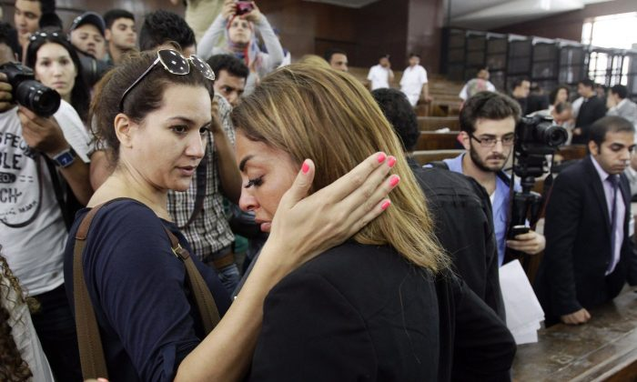 Mohamed Fahmy's fiance is consoled by a friend following the verdicts in the sentencing on hearing for three Al-Jazeera journalists, including Fahmy, in a courtroom in Cairo on June 23. The journalists were each sentenced to seven years on terrorism charges. (AP Photo/Ahmed Abd El Latif, El Shorouk Newspaper)