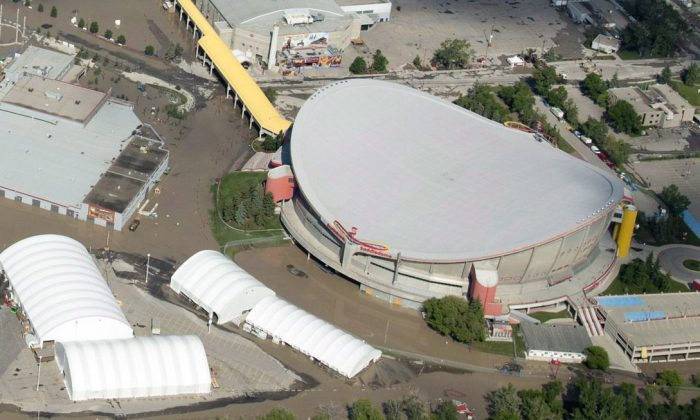 This aerial shot shows a flooded Calgary Saddledome on June 22, 2013. Social agencies are reporting an increase in domestic violence and a need for more counselling a year after devastating floods destroyed parts of southern Alberta. (The Canadian Press/Jonathan Hayward)