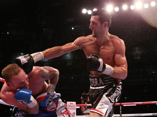 Carl Froch, right, connects with George Groves, during their IBF and WBA World Super Middleweight Title fight at Wembley Stadium in London, Saturday May 31, 2014. (AP Photo / Peter Byrne, PA)