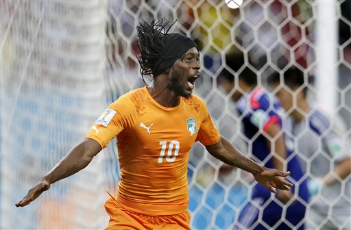 Ivory Coast's Gervinho celebrates scoring his side's second goal against Japan during the group C World Cup soccer match at the Arena Pernambuco in Recife, Brazil, Saturday, June 14, 2014. (AP Photo/Petr David Josek)