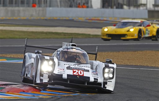 The Porsche 919 driven by Timo Bernhard of Germany, Mark Webber of Australia, and Bredon Hartley of New Zealand, in a curve of the Mans circuit, during a free practice session for the 24-hour Le Mans endurance race, in Le Mans, western France, Wednesday, June 11, 2014. The race will take place on Saturday and Sunday. (AP Photo/Remy de la Mauviniere)