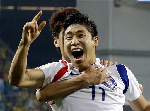 South Korea's Lee Keun-ho celebrates after scoring the opening goal during the group H World Cup soccer match between Russia and South Korea at the Arena Pantanal in Cuiaba, Brazil, Tuesday, June 17, 2014. (AP Photo/Lee Jin-man)
