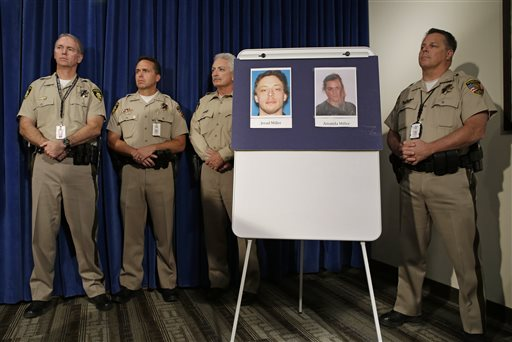 Pictures of suspects Jerad Miller and Amanda Miller are on display during a news conference, Monday, June 9, 2014, in Las Vegas. Police say two police officers, along with a bystander, were killed by Jerad and Amanda Miller yesterday. (AP Photo/John Locher)