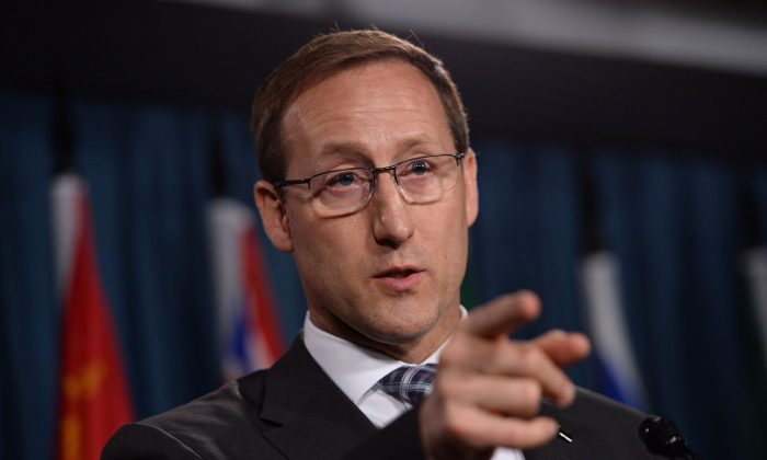 Justice Minister Peter MacKay takes questions during a news conference on Parliament Hill on June 4, 2014. The Conservative government has introduced legislation to criminalize the purchase of sexual services. (The Canadian Press/Sean Kilpatrick)