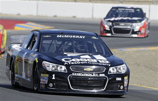Jamie McMurray leads Kurt Busch during qualifying for the NASCAR Sprint Cup Series auto race Saturday, June 21, 2014, in Sonoma, Calif. McMurray was the pole winner. (AP Photo/Eric Risberg)