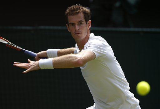 Andy Murray of Britain plays a return to David Goffin of Belgium during their first round match at the All England Lawn Tennis Championships in Wimbledon, London,  Monday, June 23, 2014. (AP Photo/Pavel Golovkin)