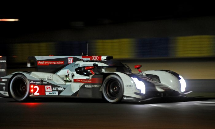 German Andre Lotterer in the #2 Audi R18 e-tron quattro competes during the 82nd Le Mans 24 hours endurance race, on June 14, 2014 in Le Mans, western France. (guillaume Souvant/AFP/Getty Images)