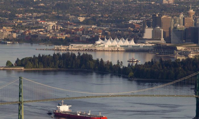 An oil tanker goes under the Lions Gate Bridge as it enters Vancouver Harbour on May 5, 2012. Now, the National Energy Board has endorsed an expansion of the Trans Mountain pipeline following a reconsideration of its impact on marine life off the B.C. coast. (The Canadian Press/Jonathan Hayward)